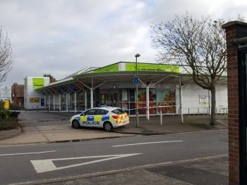 Police outside the Co-op at 12.00